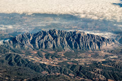 Montserrat from the sky. The grat spanish mountain Montserrat from an airplane with a cloud sea begind Royalty Free Stock Photography