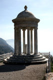 Monument. With a stone at the edge above a sea stock photography