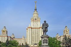 Monument against university. Monument to Lomonosov before a Moscow State University building Royalty Free Stock Photography