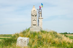 Monument athlete knight with a sword and the flag of Ukraine Royalty Free Stock Images