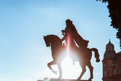 Monument on the background of blue sky backlit. Monument to King on a horse in Lviv Stock Photography