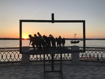 Monument `Barge Haulers on the Volga` on the background of the river and the sunset summer sky stock photos