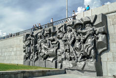 Monument-bas relief The Birth of the city Stock Photos