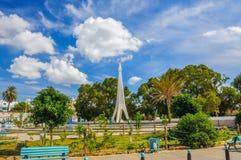 Monument with blue sky and trees near Medina in Hammamet Tunisia Stock Photos