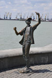 Monument-boy fisherman. Monument boy-fisherman in the port city Royalty Free Stock Photos