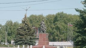 Monument in centre of Russian town. Green trees on background. stock footage