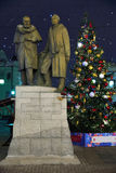 Monument  in Chamberlain lane on the Christmas tree  background at night, Moscow, Russia Royalty Free Stock Photos