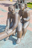 Monument children. Bronze statue of children swinging on a swing Royalty Free Stock Image