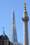 The Monument In City of London against The Shard skyscraper in L Stock Images