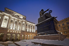 Monument of Copernicus in Warsaw during night Stock Images
