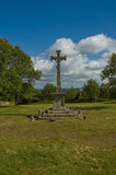 Monument with crucifix in the countryside Stock Photography