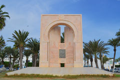 Monument de la solidarité nationale. Monument dedicated Tahar Sfar is located in a beautiful park on the coast, surrounded by tall palm trees, right next Stock Photos