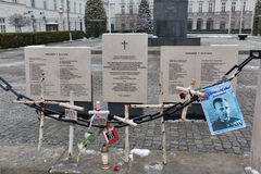 Monument dedicated to people died in air crash. Warsaw, Poland. Memorial monument in front of Presidential Palace with names of president Lech Kaczynski and 95 Stock Photos