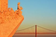 Monument of Discoveries along the Tagus River and 25 de april bridge in Lisbon. Sunset over the Monument of Discoveries along the Tagus River, in the civil Stock Image