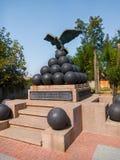Monument eagle sitting on core, Ochakov, Ukraine.  Royalty Free Stock Photography