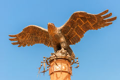 Monument of an eagle with spread wings. Memorial monument of an eagle with spread wings Royalty Free Stock Photo