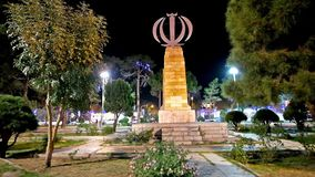 The monument with Emblem of Iran. YAZD, IRAN - OCTOBER 17, 2017: Beautiful monument with Emblem of Iran located in the garden in Shahid Baheshti square, on stock video