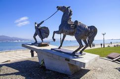 Monument of emigration in 1920. The monument depicts a white officer with his war horse, which he is trying to bring to the ship, sailing into exile stock image