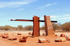 Monument at the entrance of the Red Centre Way, Australia. Monument at the entrance of the Red Centre Way along the Lasseter Highway to Uluru Ayers Rock at the Royalty Free Stock Photos
