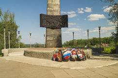 Monument and eternal flame with wreath. On background blue sky Royalty Free Stock Images