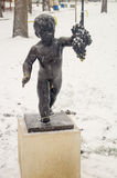 Monument grape boy under snow in Pomorie, Bulgaria stock photo