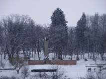 Monument of the Great Patriotic War of 1941-1945 in a snow-covered park. In a cloudy day Stock Photos