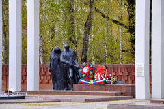 Monument Grieving mother and the young soldier. Tyumen Stock Photos