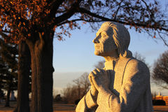 Monument kneeling in prayer with hands clasped Royalty Free Stock Photo