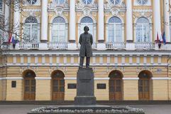 Monument Konstantin Ushinsky. Building Herzen University in St. Petersburg Royalty Free Stock Photos