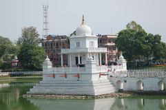 Monument in a lake in Kathmandu, Nepal. Detail of a small palace monument in a lake in downtown Kathmandu, Nepal stock photo