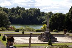 Monument at a lakeside. Blenheim Palace garden in Woodstock, Oxfordshire, England Royalty Free Stock Image