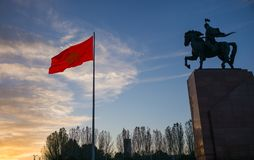 Bishkek, Kyrgyzstan: Monument for Manas, hero of ancient kyrgyz epos, together with national Kyrgyzstan flag on Bishkek central Al. Monument for Manas, hero of royalty free stock photos