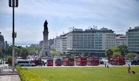 Monument on the Marques de Pombal square. View of Eduardo VII park and Marques de Pombal square, Lisbon, Portugal. Parking of sightseeing buses Stock Photos