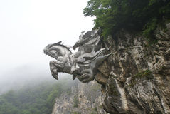 Monument merged with the rock. Horseman (Saint George) on horseback. The North Ossetia (Russia Royalty Free Stock Image