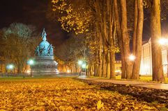 Monument Millennium of Russia in Veliky Novgorod in autumn night and alley of Kremlin park in the night time. Veliky Novgorod, Russia. Monument Millennium of Royalty Free Stock Image