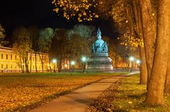The monument Millennium of Russia in Veliky Novgorod in autumn night and alley of Kremlin park in the night time. Veliky Novgorod, Russia. Monument Millennium of Stock Photography