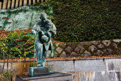 Monument at Minoo waterfall, Osaka. Man carry mom monument at footpath along Minoo or MInoh waterfall, Osaka, Japan Stock Photos