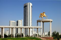 Monument and modern buildings as background stock photography