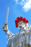 The monument `Mother Motherland` decorated with a wreath of poppies on the Day of Remembrance and Reconciliation Royalty Free Stock Image