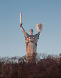 Monument of motherland in Kiev. Monument of motherland above forest in Kiev Stock Image