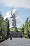 Monument Motherland in Volgograd, people walking by. Royalty Free Stock Photo