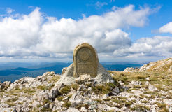 Monument in mountains Stock Images