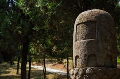 Monument near the road in China. Amount the forest Royalty Free Stock Image