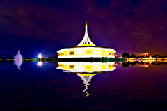 Monument in the night time with reflection on the water at publi Stock Photography