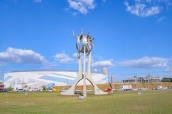 Monument O Passageiro in Londrina city. Londrina, Brazil - July 31, 2017: Monument O Passageiro in front of Terminal Rodoviario de Londrina. Tall metal sculpture Stock Images