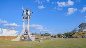 Monument O Passageiro in Londrina city. Londrina, Brazil - July 31, 2017: Monument O Passageiro in front of Terminal Rodoviario de Londrina. Tall metal sculpture Stock Image