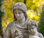 Monument Of The Woman With The Child On A Cemetery Stock Images