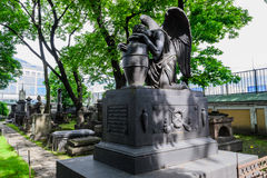 The monument in the old cemetery in St. Petersburg. Angel. The symbol of the Christian faith. Lazarevskoe cemetery in St. Petersburg Stock Photo