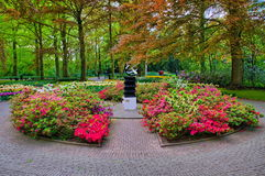 Monument among pink flowers, Keukenhof Park, Lisse in Holland Royalty Free Stock Photography