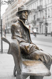 Monument on Piotrkowska Street in Lodz - A man sits on a bench Royalty Free Stock Photography